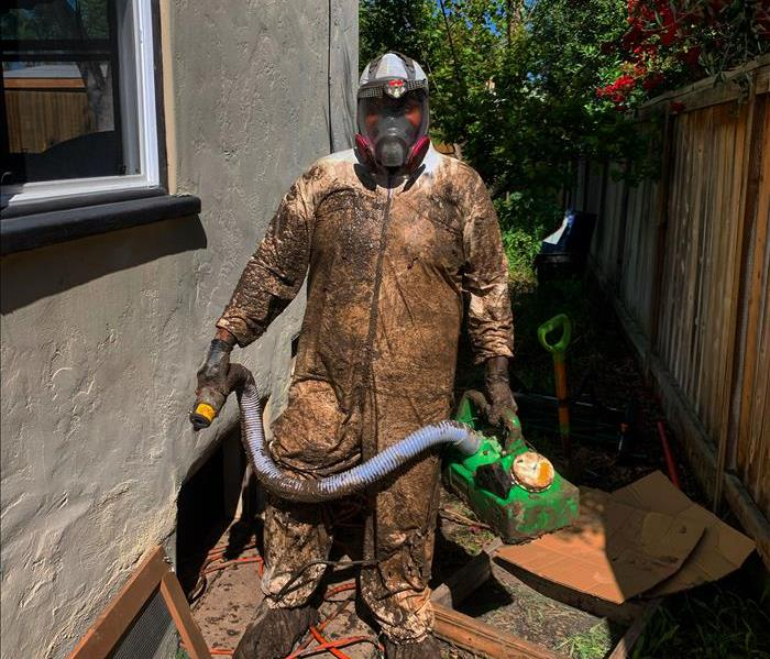 SERVPRO of Mid-City San Diego production tech muddy from head to toe
